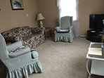 Family room with TV, Sling and Netflix channels.