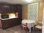 Kitchen with microwave, refrigerator.