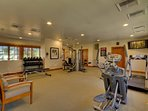 Feel like a workout? The fitness room is outfitted with all of the essential equipment, plus a flatscreen TV.