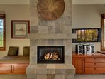 There is additional built-in cabinetry and seating next to the slate fireplace.