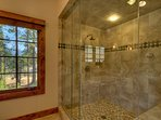The huge walk-in steam shower in the master bathroom
