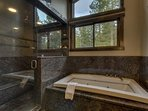 The attached bathroom includes a jetted tub and stand up shower.