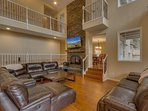 High ceilings and gorgeous stonework adorn the main living area