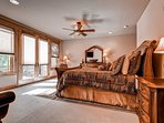 The main level master bedroom #1 has a king bed, mountain views, TV, private balcony, and private bath.