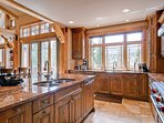 Your finely-tuned family of chefs can work together in this spacious kitchen with double ovens, two sinks, and massive...
