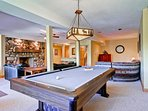 The downstairs game room features a fireplace, pool table, card table, and bar with microwave and sink.