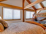The upstairs master bedroom #2 has a queen bed and twin bunk, TV, and private bath.