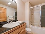 The downstairs bathroom is shared by two bedrooms and features a tub/shower combo.