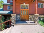 The rustic exterior of Antler Ridge features river rock accents.