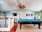 Play pool and watch movies in this 3rd floor room with hardwood floors. It has 2 twin trundle beds that sleep 4 (guest...
