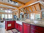 The professional kitchen has nice built-in appliances, granite countertops, and room for several helpers.