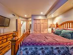 The guest master is located on the top floor and features a TV and en suite bathroom.