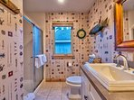 Guest Bathroom 3 has a stand-alone shower and two large basin sinks.