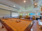 This game room and home theater is built for a King (or queen, or many princes and princesses).
