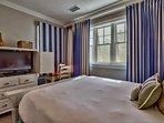 Guest Bedroom 3 features a queen sized bed, TV and en-suite bathroom.