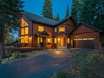 The grand lodge architecture is a warm, welcoming sight amid the woods of North Lake Tahoe.