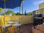 You can grill with a view on this patio, right outside the kitchen.