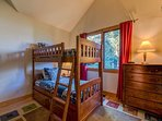 On the main level, the kids will flock to the twin bunk beds - plus the two twins in the loft off this room.
