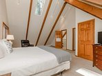 The spacious Master Bedroom #1 has a king bed and huge vaulted ceilings, as well as a tv.