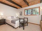 Guest Bedroom #3 has a comfy queen bed and a flat screen.