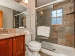The shared bathroom on the first floor has a tub/shower combo.