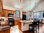 It's a joy to cook in this kitchen with granite countertops and lots of natural light.