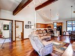 The high vaulted ceilings, impeccable design, and stylish layout make relaxing in the living room a treat.