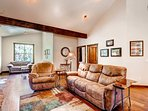 Comfortable recliners and rustic furniture to relax in this mountain setting.