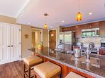 The big kitchen has stainless steel appliances, seating for 3 at the breakfast bar and enough counter space for the...