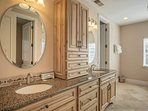 Twin sinks in the private master bathroom offer plenty of room for primping before enjoying a night out in South Lake...