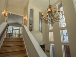 Head upstairs to the upper level living area and master suite.