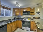 The kitchen includes all the essential appliances and cooking utensils.