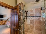 The master is also home to a beautiful stone shower.