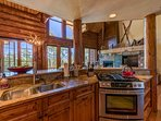 The open kitchen allows the cook of the family to participate while preparing that next delicious meal.