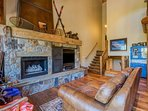 The giant stone fireplace and entertainment center take center stage in this great room.
