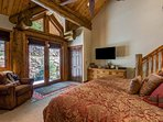 The master bedroom opens up to the back patio should you want a little quiet with your morning coffee.