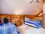 Kids will love all being together in the loft bedroom.