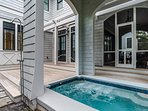 Turn on the fountain to enjoy the gentle sounds of flowing water from your covered private pool.