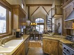 The kitchen has plenty of counter space and all the appliances you need for a home cooked meal.