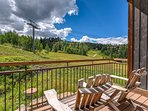 Two Adirondack chairs on the deck offer incredible views of the slopes.