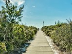 The boardwalk will lead you to sugar-white sand shores and beautiful blue skies.