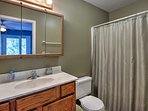 Take a warm shower in the en-suite bathroom to relax before bed.