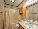 The third bathroom boasts a shower/tub combo.