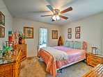 Climb under the covers of this queen bed in the third bedroom.