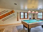 The downstairs area also has a pool table!