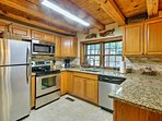Make all of your favorite meals in the fully equipped kitchen .