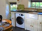 Kitchen-diner showing the washer-dryer machine.