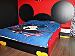 Mickey Mouse Master Bedroom with King Size Bed and Swimming Pool view