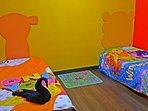 Winnie The Pooh & Tigger Bedroom with 2 Single Bed. Enjoy with Winnie The Pooh & Friends accompanies