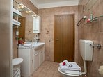 The bathroom with shower, toilet and bidet